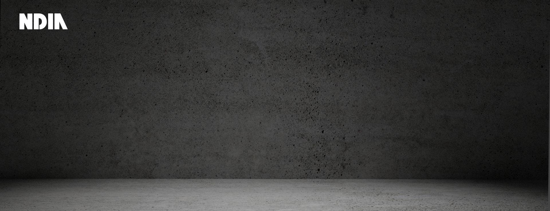 Dark background with the NDIA logo in the corner.